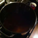 Heating some cider for the honey
