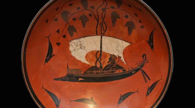 Interior of a black-figure kylix depicting Dionysus on a ship festooned with grapevines sailing among jumping dolphins